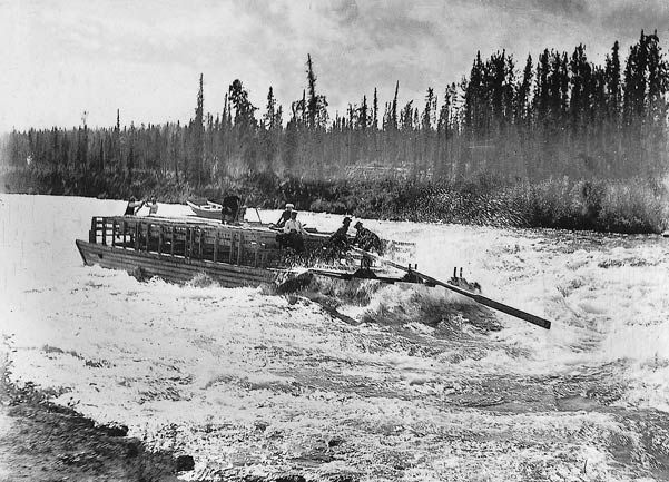 "Stampeders running the Whitehorse Rapids Whitehorse is named after the historic rapids on the Yukon River which resembled the flowing manes of charging white horses. On the ""Trail of '98"", the stampeders had to bypass the treacherous water of Miles Canyon and White Horse Rapids, south of the present city."