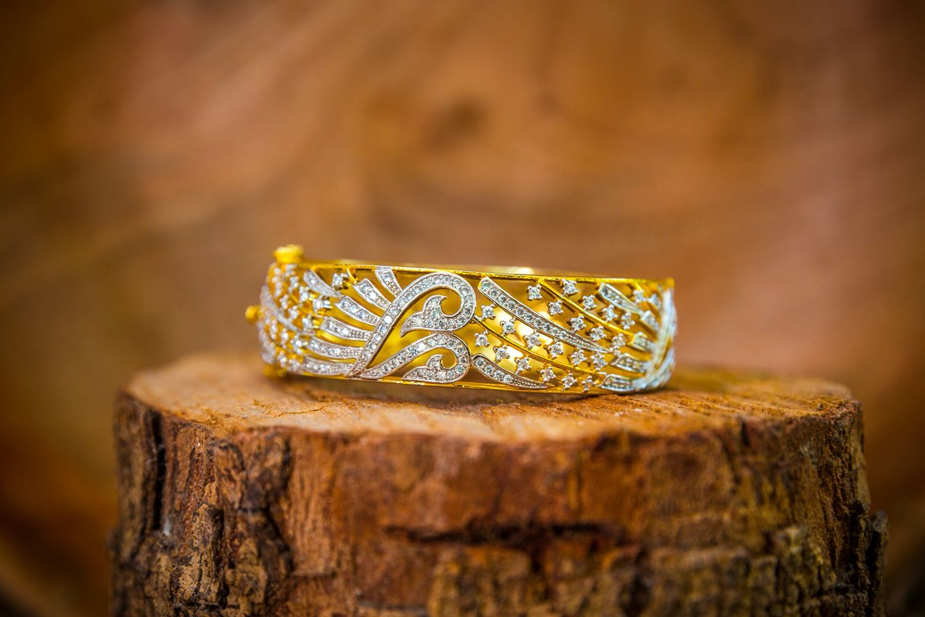 Mora   Inspired by the intricate detains of the peacock feather. 18k gold electroplated.   Available at http://www.gvccustomgold.com