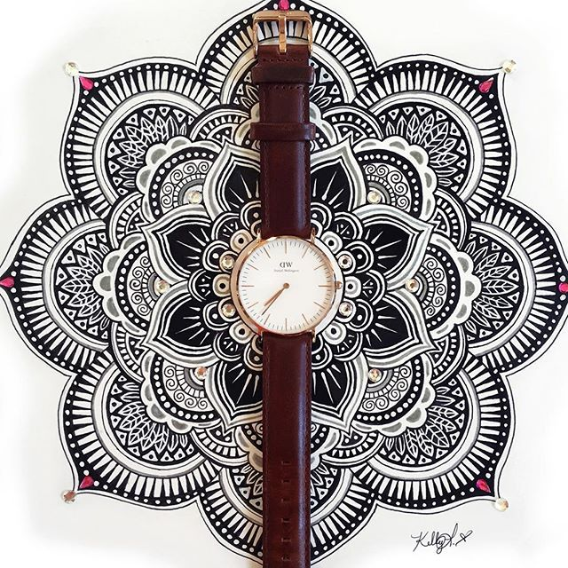 WEBSTA @ kellylahar - Finished my Mandala just in time for my @danielwellington watch to arrive! These watches are some of my favorites, I may have a slight watch fetish If you want to get one (Christmas is coming!) use discount code DWKellylahar for 15% off! See the Mandala without the watch on my Lahar Studios Facebook page!! #danielwellington #danielwellingtonwatch #mandala #drawing #decorative #design #prismacolor #marker #jewels