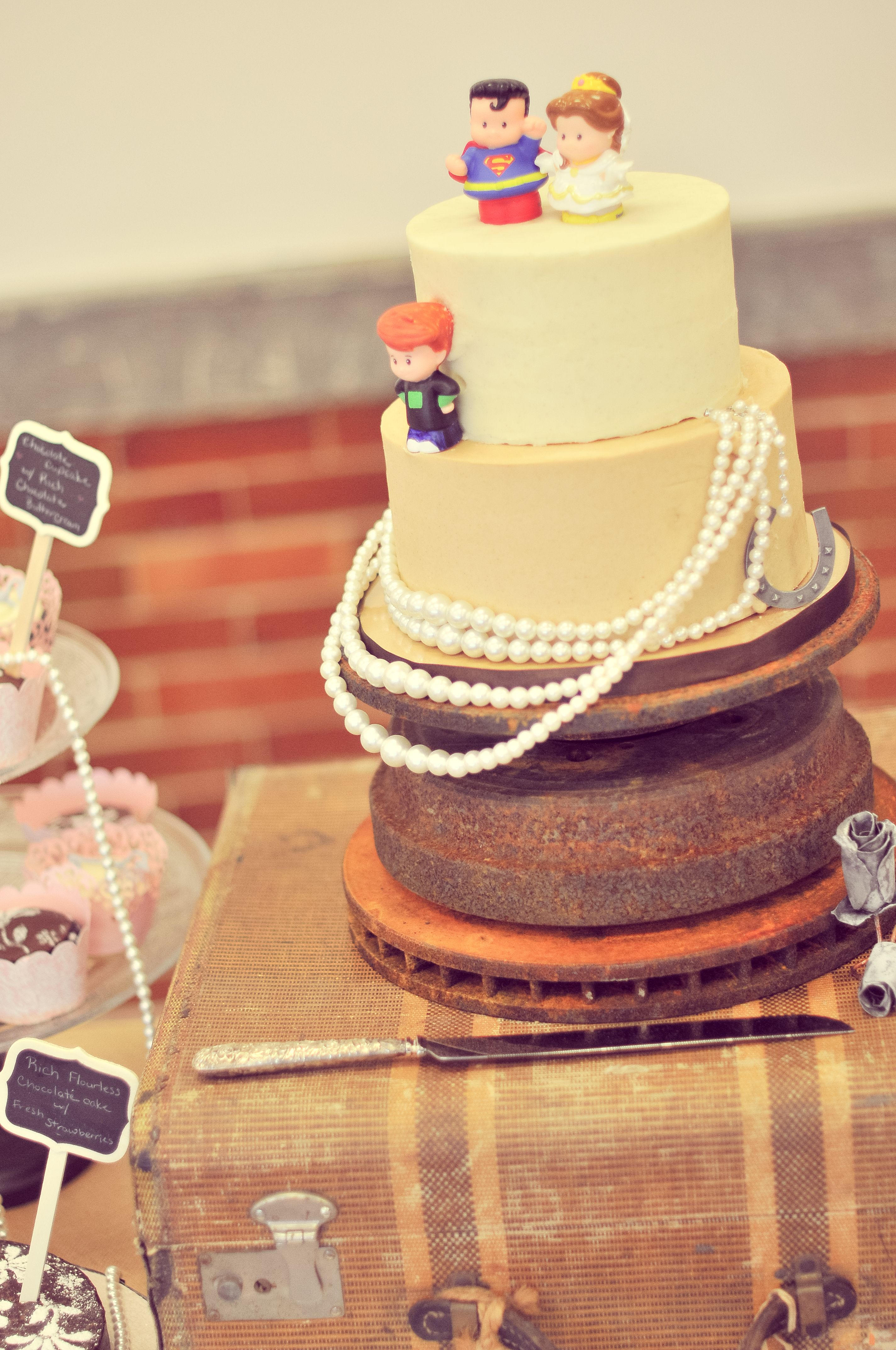 my wedding cake, on a brake rotor stand, pearls, fisher price little ...