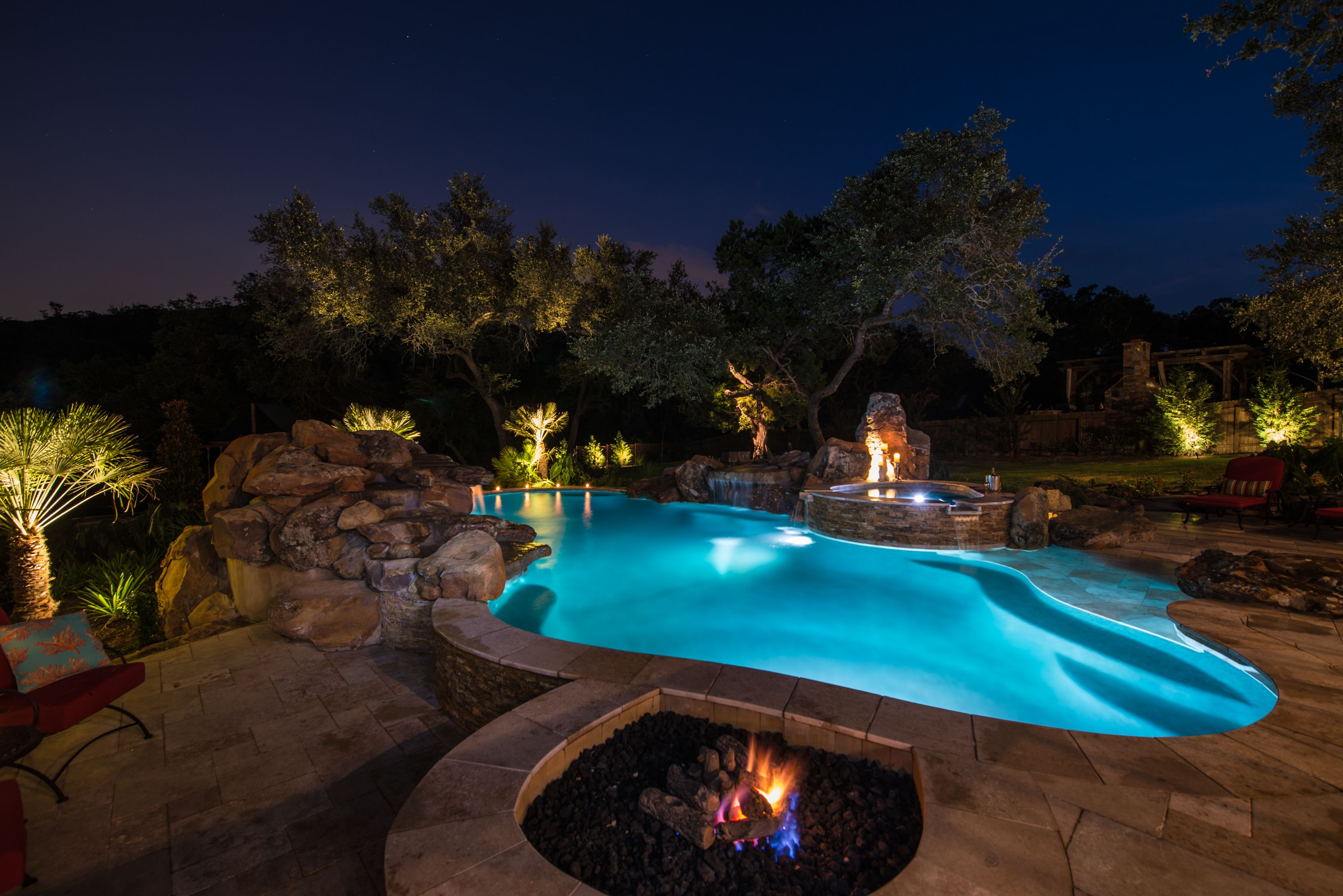 fire pit spa huge rock waterfall with grotto and a beach entry