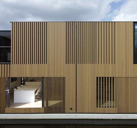 Dezeen timber door google search outdoor and garden for Architecture facade villa