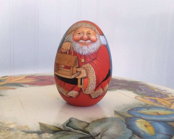 Santa with a bird feeder on the front and a pair by WoodenEggArt, $65.00