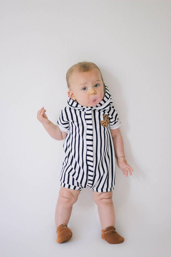 723f87f7e9b This romper is made out of butter soft and stretchy knit fabric. It has  snap going from crotch to the neck opening. Plenty of room for a diaper.