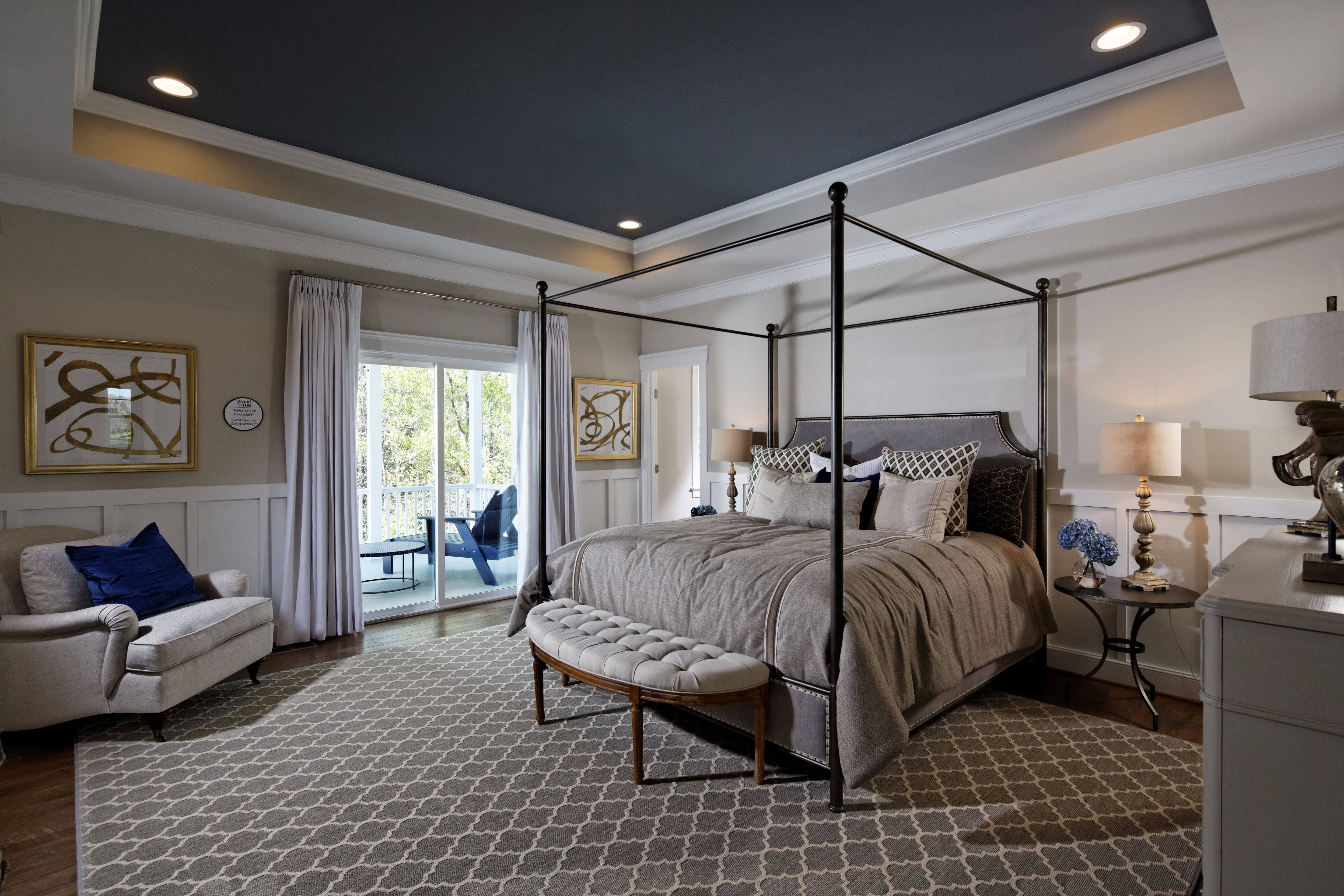 A patterned area rug spans across the Kensington II model\'s master ...