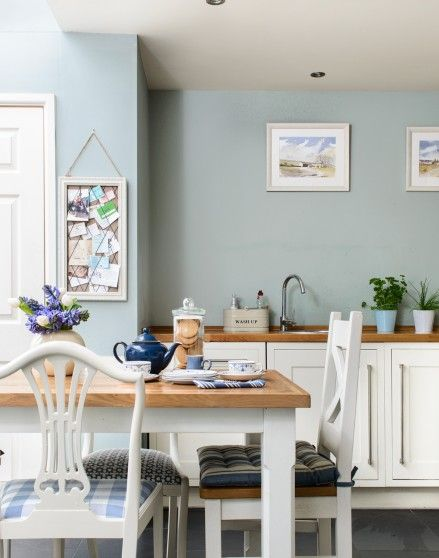 Need country kitchen decorating ideas? Take a look at this country-style kitchen with duck egg blue walls and white cabinets. Find more kitchen decorating ... & Need country kitchen decorating ideas? Take a look at this country ...