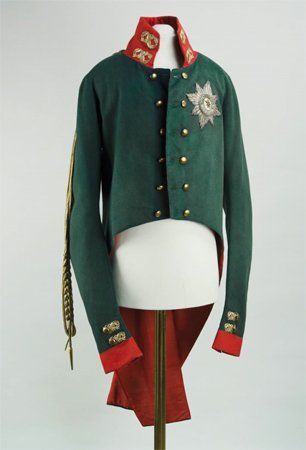 Coronation uniform of Emperor Alexander I, circa 1801.  This uniform has a high collar, embroidered with gold threads.  The right shoulder bears a long piece of gold braid ending in an aiguillette. The chest bears the star of the Order of St. Andrew the First-Called, embroidered in silk and gold. The coat has been sewn by Alexander Golitsyn in 1801.  This image is from the Victoria and Albert Museum's website.