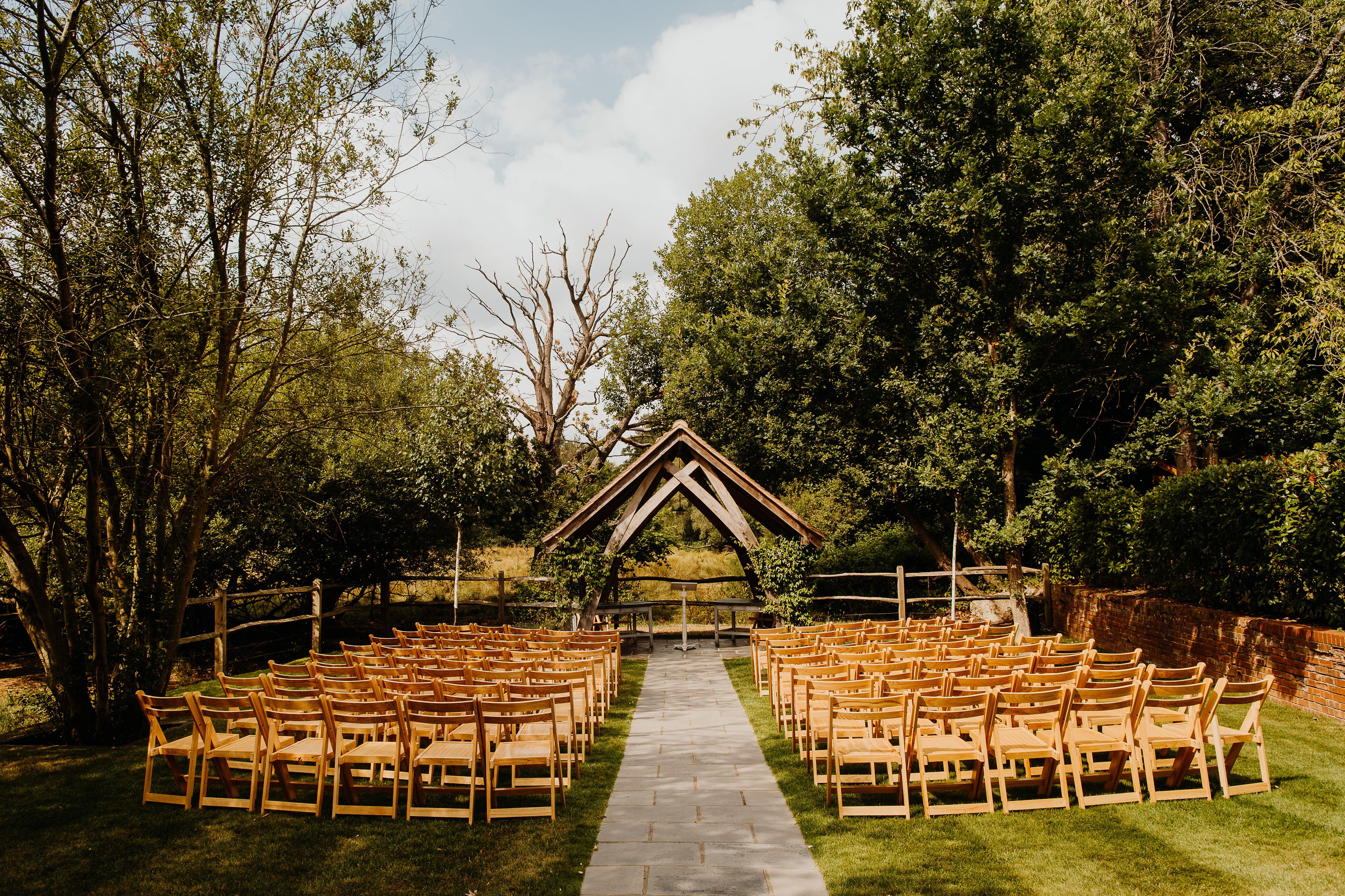 Countryside Outdoor Wedding Ceremony Surrey Uk At Barn Wedding Venue Millbridge Court Rustic Wedding Venues Surrey Rustic Summer Wedding Barn Wedding Venue