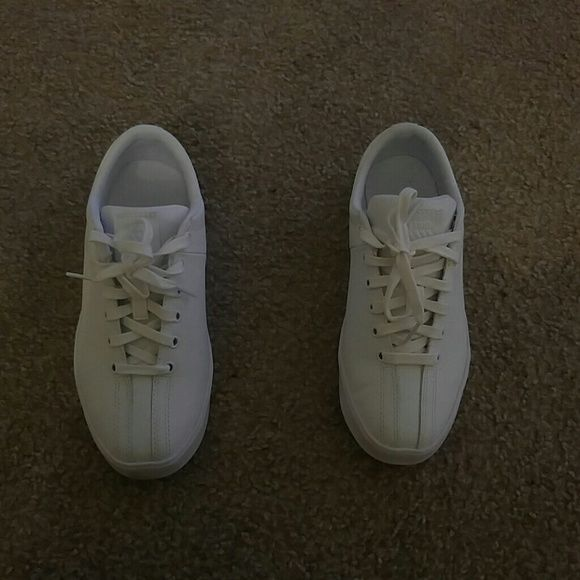 Sneakers All White plain K-Swiss. Never worn, came out of box as is. Doesn't have the K-Swiss classic stripes down the sides. Box can be included Kswiss Shoes Sneakers
