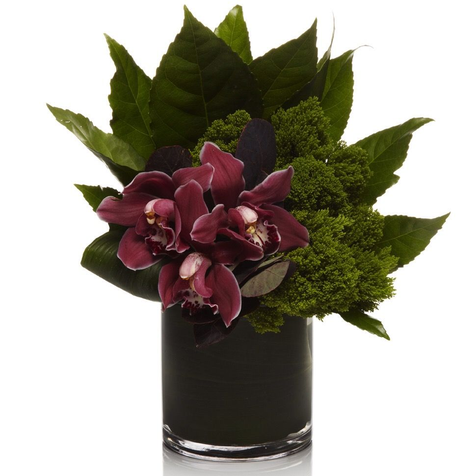 Purple orchid and deep green modern centerpiece flower