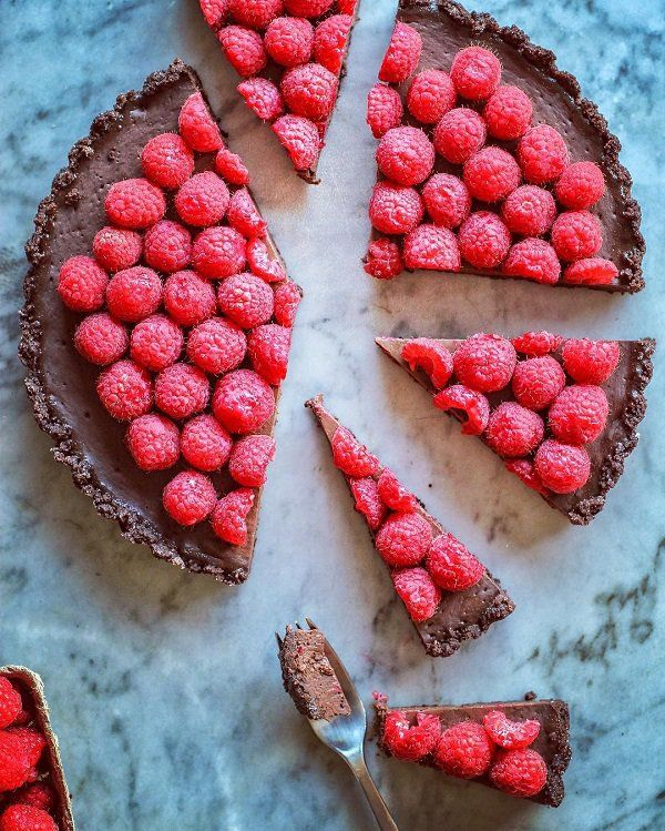 Even those who are not fans of a combination of chocolate and fruit will enjoy the taste of candy. From flour, yogurt, sugar, cocoa, oil and grated chocolate bake the crust for the first tart. Then preparer fill from raspberries and sugar. Then add the cornstarch. Fill pour over hot crust. Over fill follows glaze of dark chocolate, milk and butter. On top put raspberries to decorate cake serve when it is cold well!