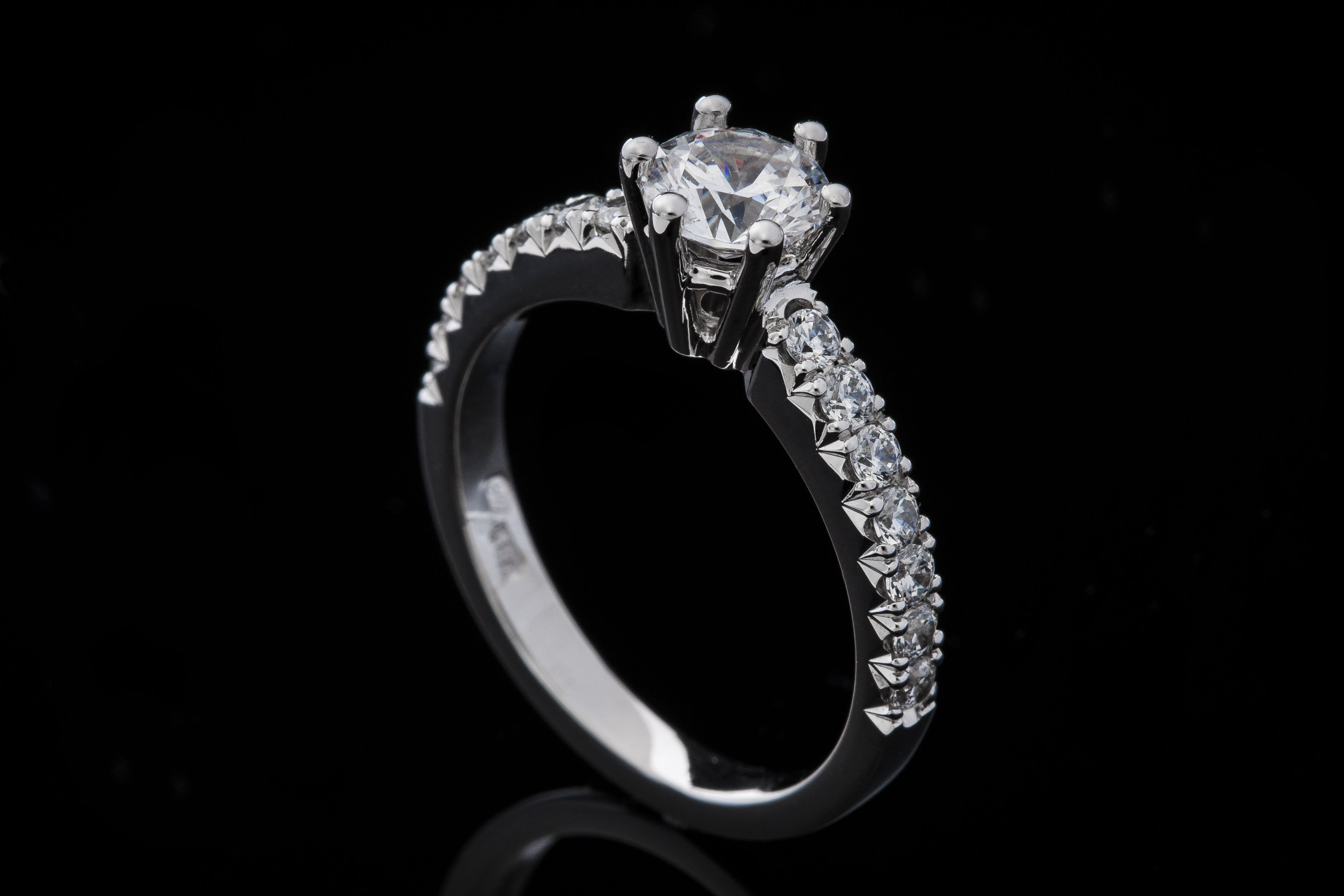 Handcrafted solitaire engagement ring with diamonds