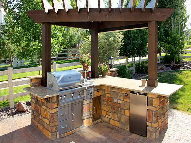 Outdoor kitchen with a barbecue and bar fridge. This will ...