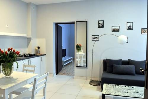 Apartamenty Wadowity 4A Wadowice Apartamenty Wadowity 4A is set in Wadowice, 300 metres from Museum Family Home of John Paul II. Free WiFi is featured throughout the property.  The accommodation comes with a seating area. Some units feature a dining area and/or balcony.