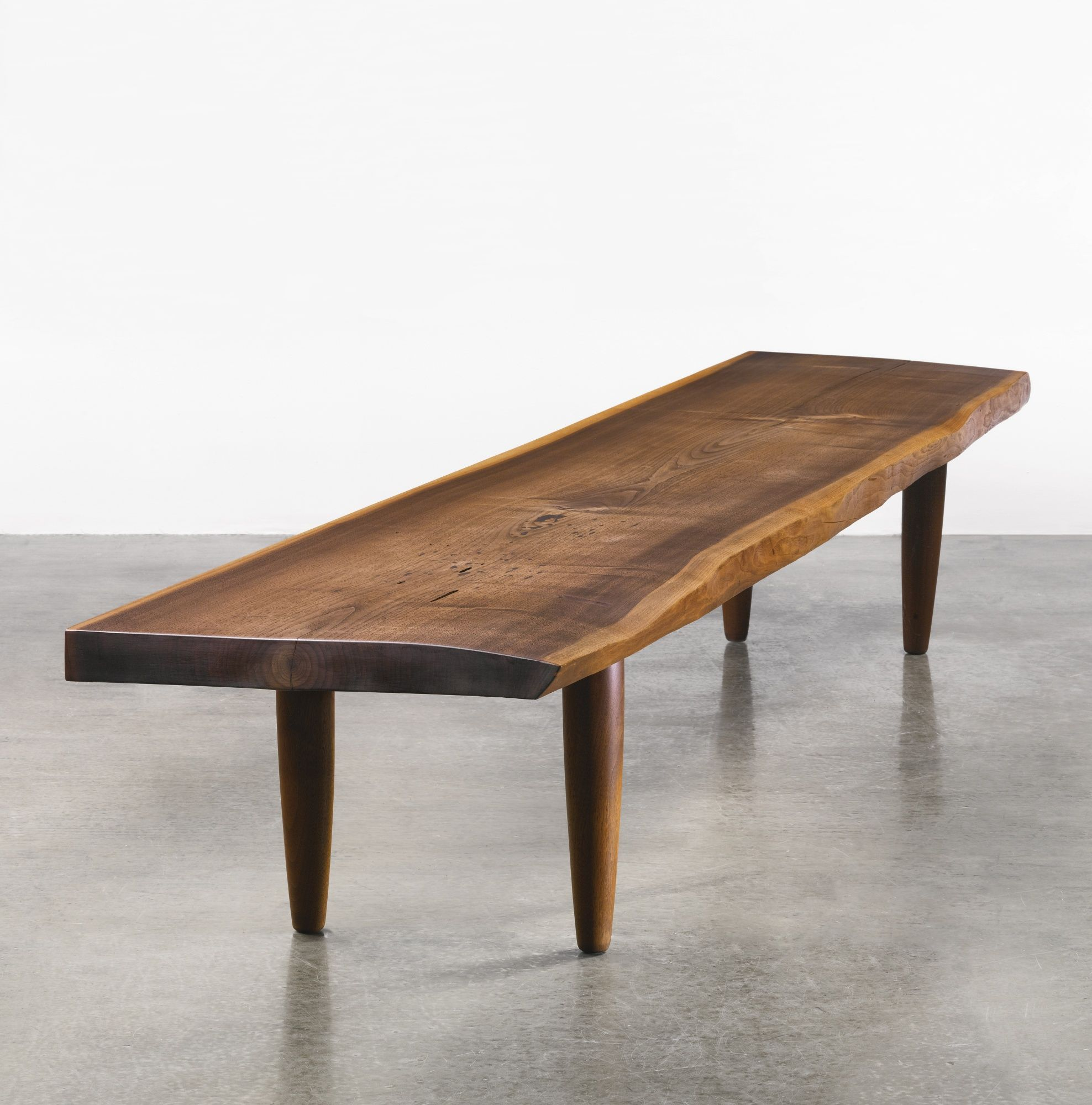 George Nakashima; American Black Walnut and East Indian Rosewood Bench, c1950.