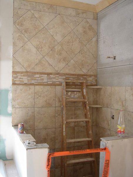 Bathroom Shower Tile Natural tones accent border mosaic with 12x12 top diagonal  bottom