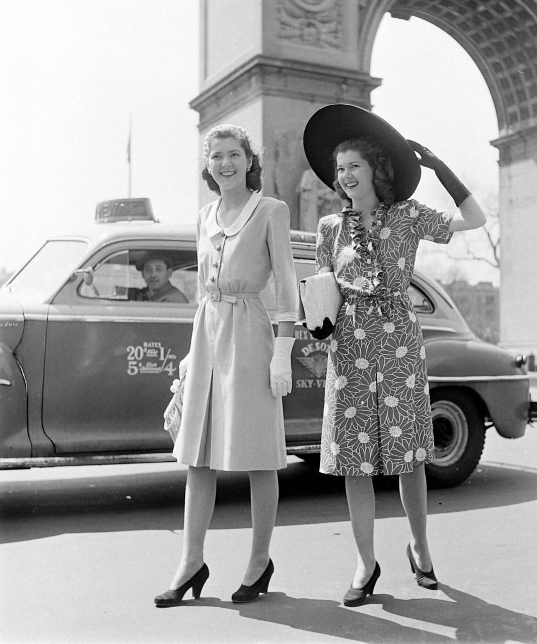 1940s--Washington Square, NY. Taxi fares, posted on cab door, are ...