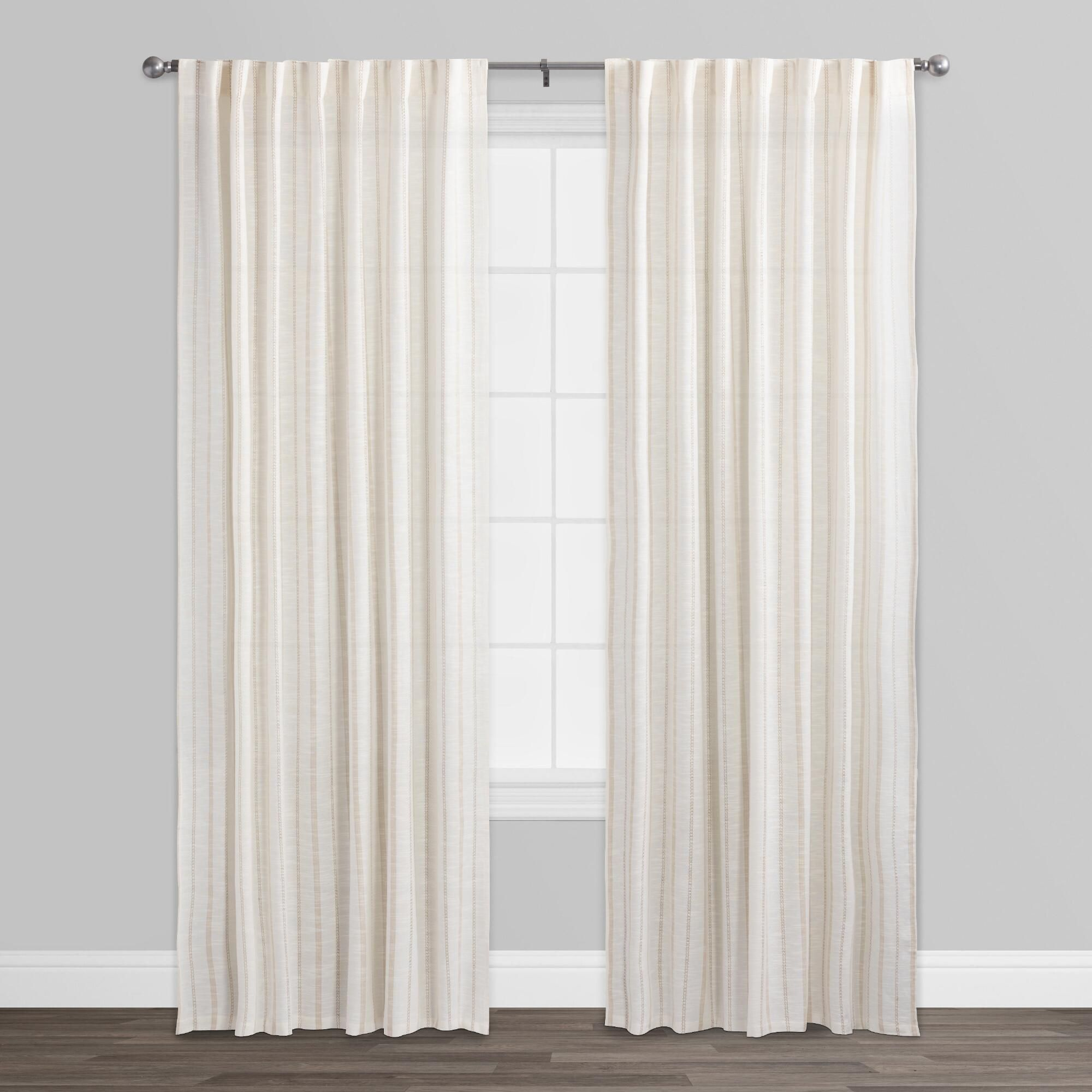 the dobby striping in our cotton slub curtains weaves ivory under the dobby striping in our cotton slub curtains weaves ivory under a tan vertical design