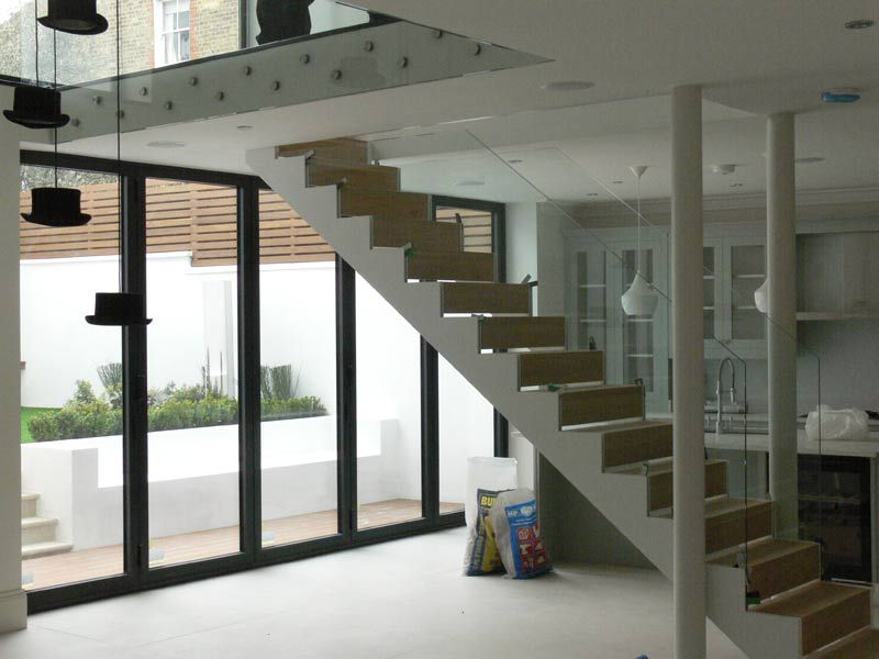 A Steel Staircase With Stainless Steel Handrails And Pan