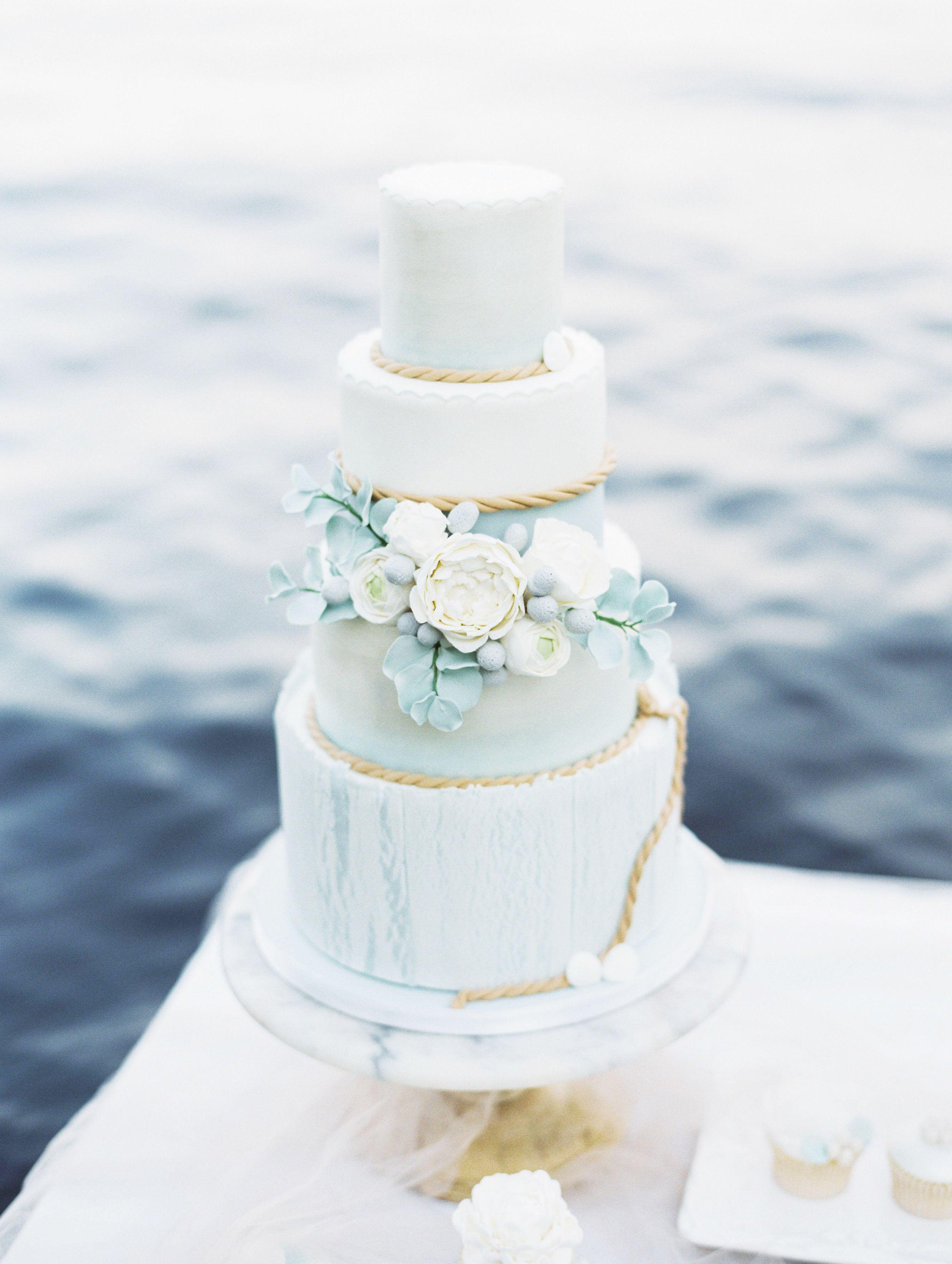 Coastal themed wedding cake. Blue and white wedding cake with washed ...