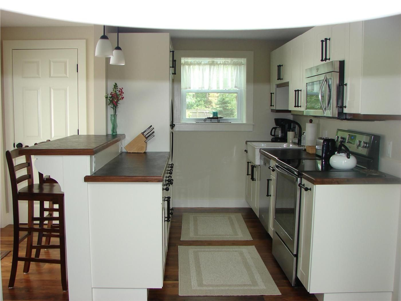 Great galley kitchen with open feel and breakfast bar ...