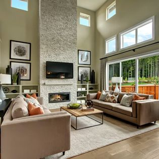 Great Room With Two Story Stone Fireplace And Built In Shelving
