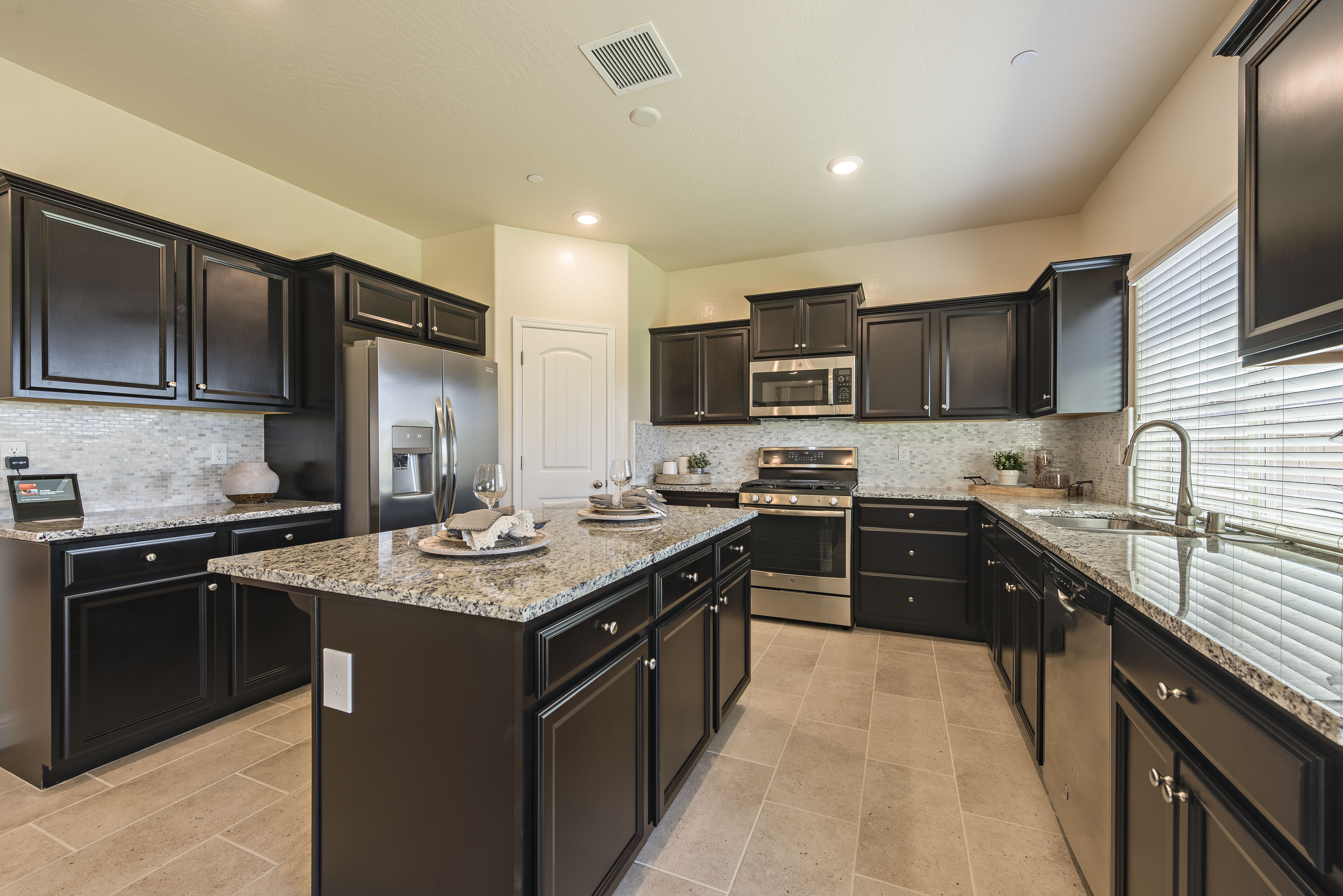 Spacious Traditional Kitchen With Middle Island And Dark Cabinets New Homes For Sale New Home Construction New House Plans