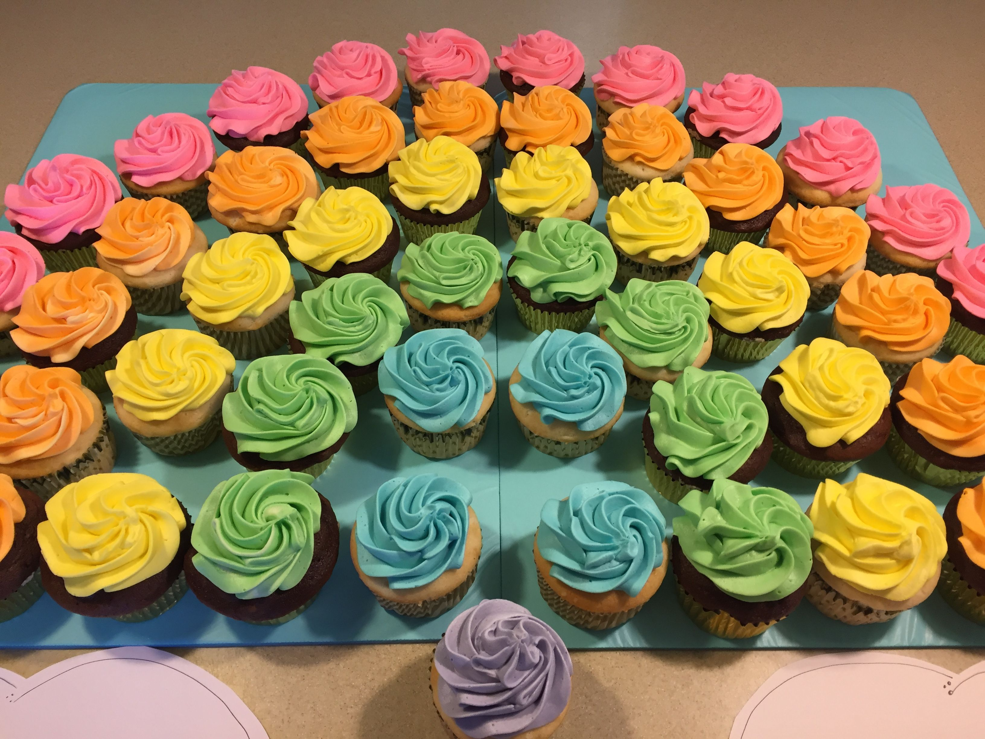 Rainbow cupcakes. The purple one goes In the middle ...
