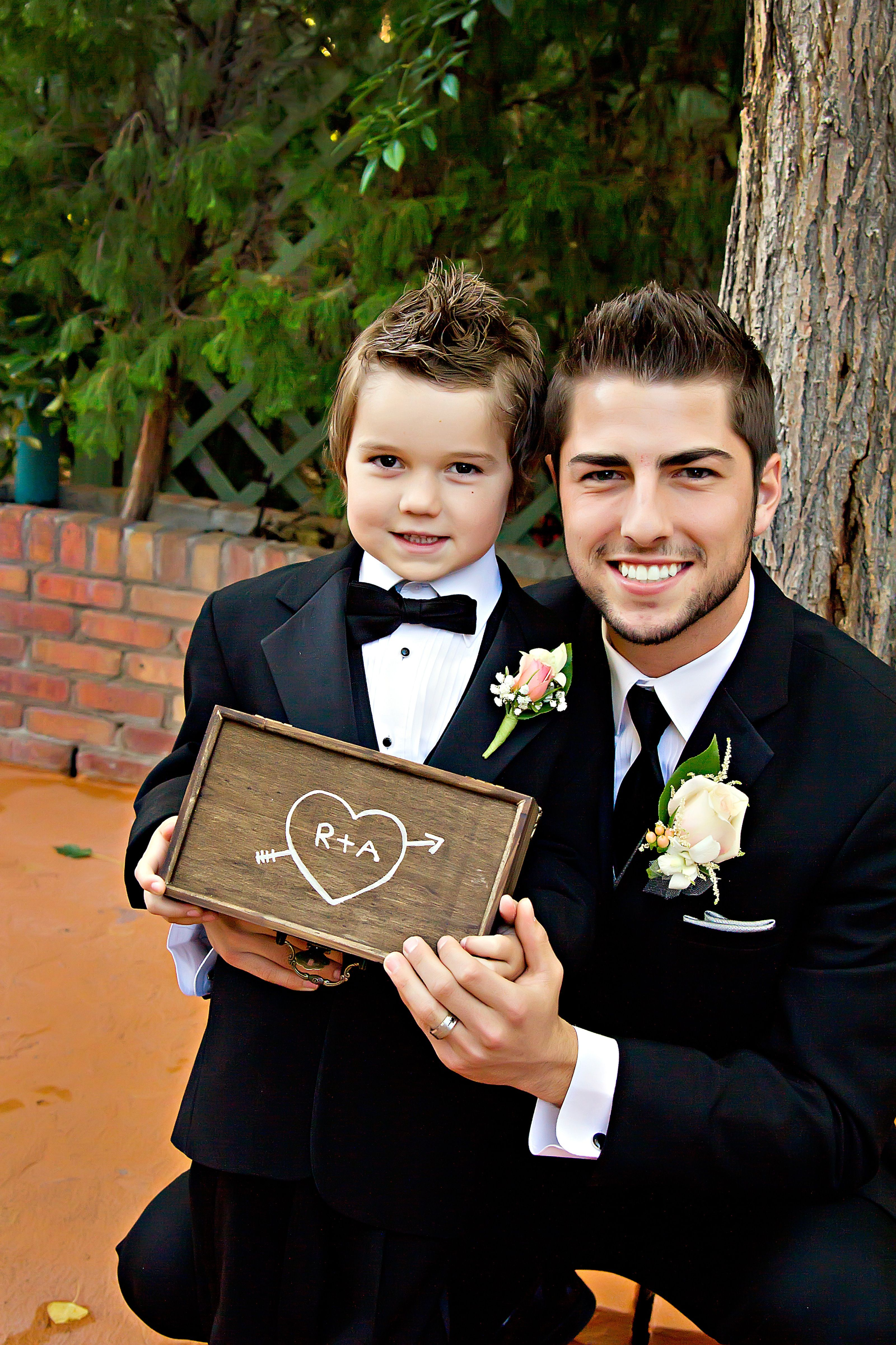 Groom and the ring bearer wedding wedding party