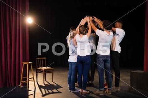 Actors team forming their hands stacked Stock Photos formingteamActorshands