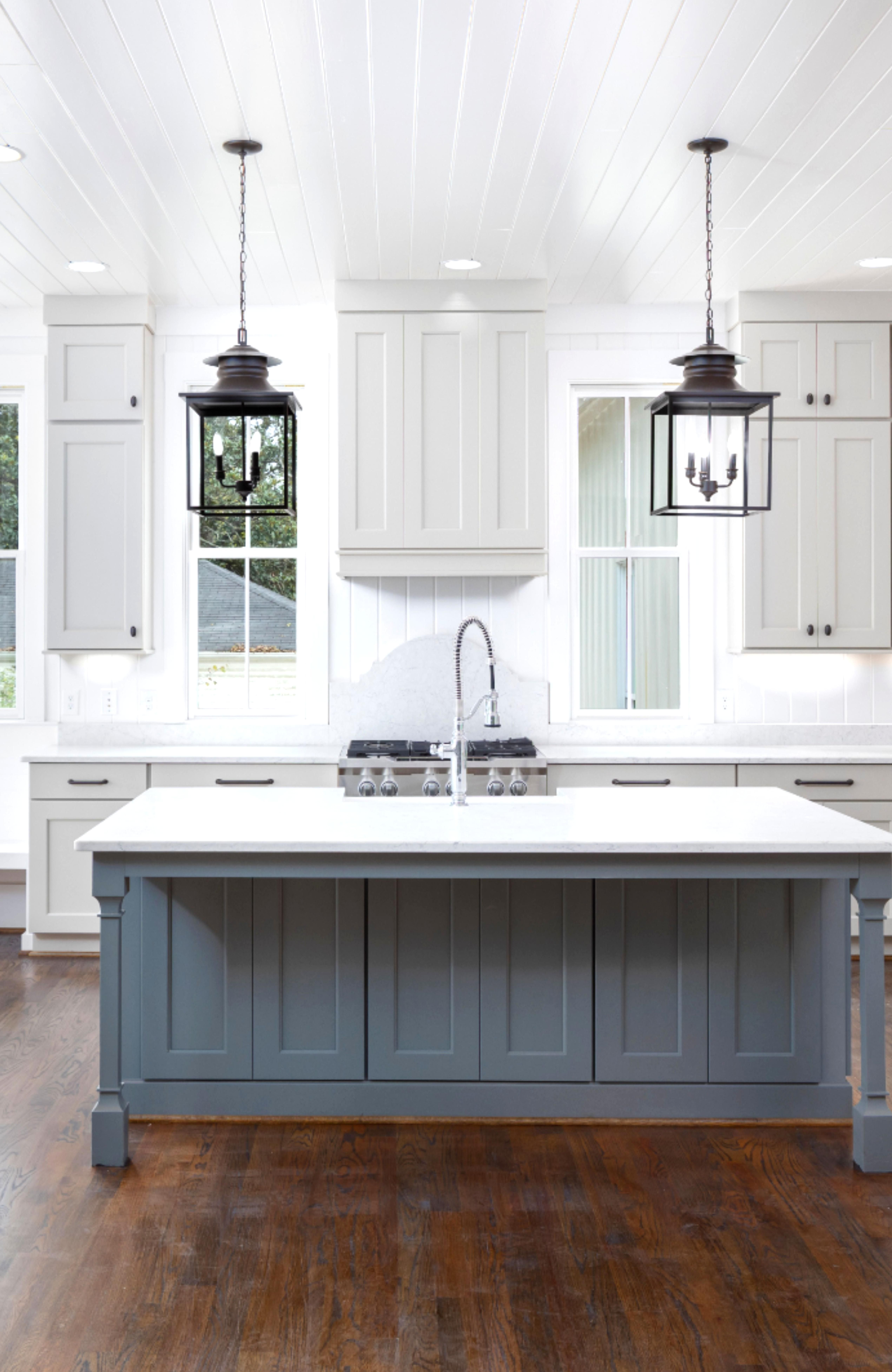open kitchen with light gray cabs large dark gray island and lantern pendant lights in 2020 on kitchen decor grey cabinets id=66277