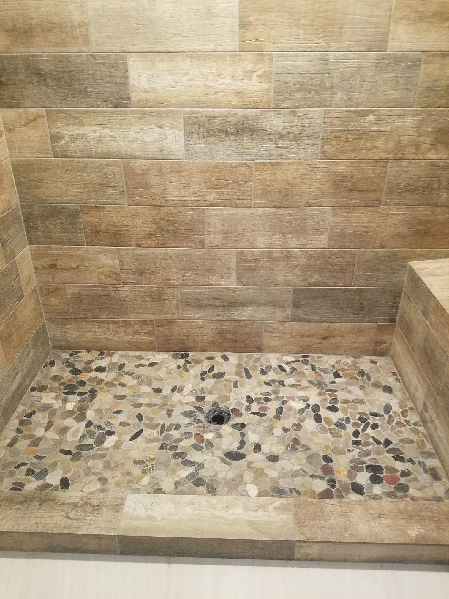 Wood Tile Shower Walls With River Rock Floor In Finished Basement Bathroom Wood Tile Shower Basement Bathroom River Rock Floor