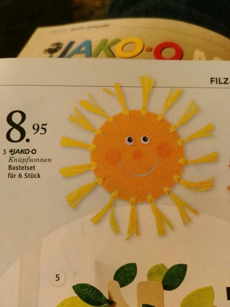 Die Sonne ist aus Holz, kann man aber auch aus Fotokarton basteln...