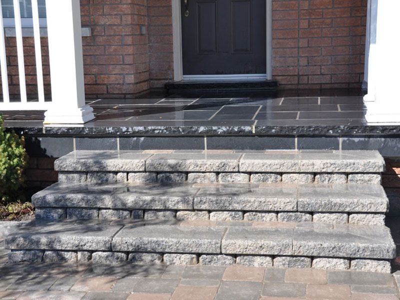 Natural stone porch with interlocking steps ma maison for Exterior stone stairs design
