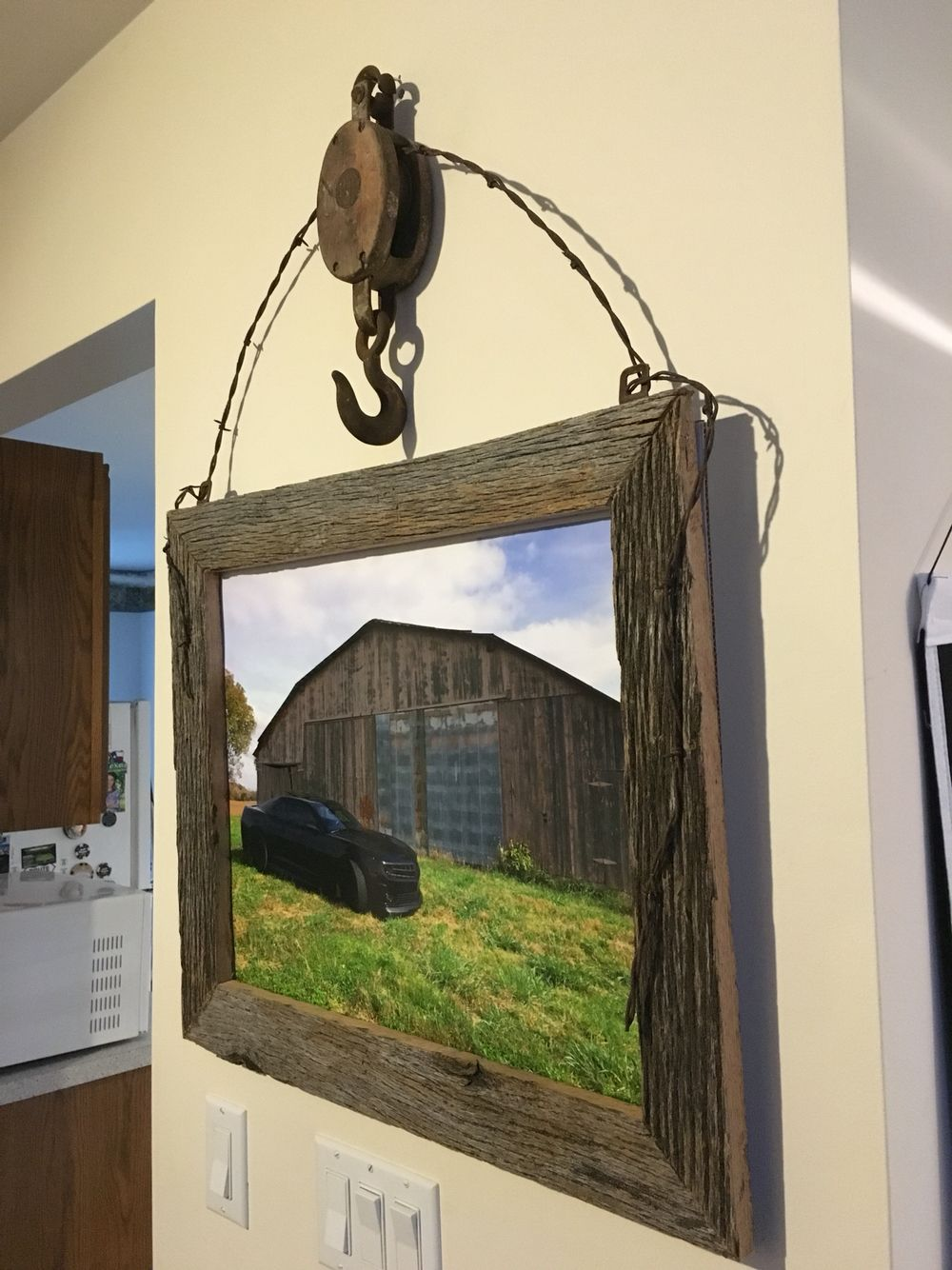An Old Barn Pulley Some Barb Wire Barn Wood And There You Have It A Rustic Picture Frame Rustic Picture Frames Barn Decor Rustic Pictures