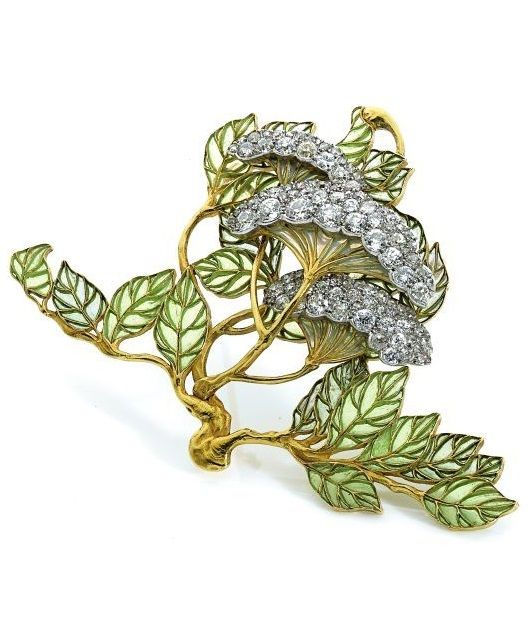 Lalique 1900 'Art Nouveau' Brooch: platinum, gold, enamel, diamond brooch. Designed as hydrangea flowers mounted in platinum & set w/diamonds, the leaves decorated w/translucent clear & bluish green enamel mounted in gold. Signed. The preparatory drawing of this jewel is in the catalogue raisonné 'Lalique' by Sigrid Barten as No. 645