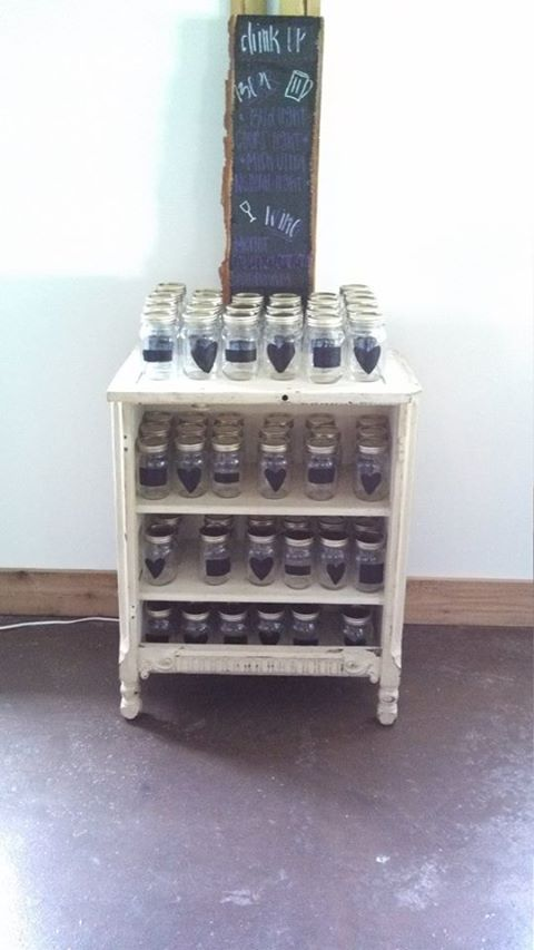 Mason jars with chalkboard paint. Make sure you use the chalkboard paint for glass.