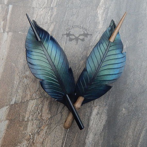 Photo of Iridescent crow feather leather hair slide hair clip or scarf pin. Black bird or raven hair accessory with Gothic boho style.