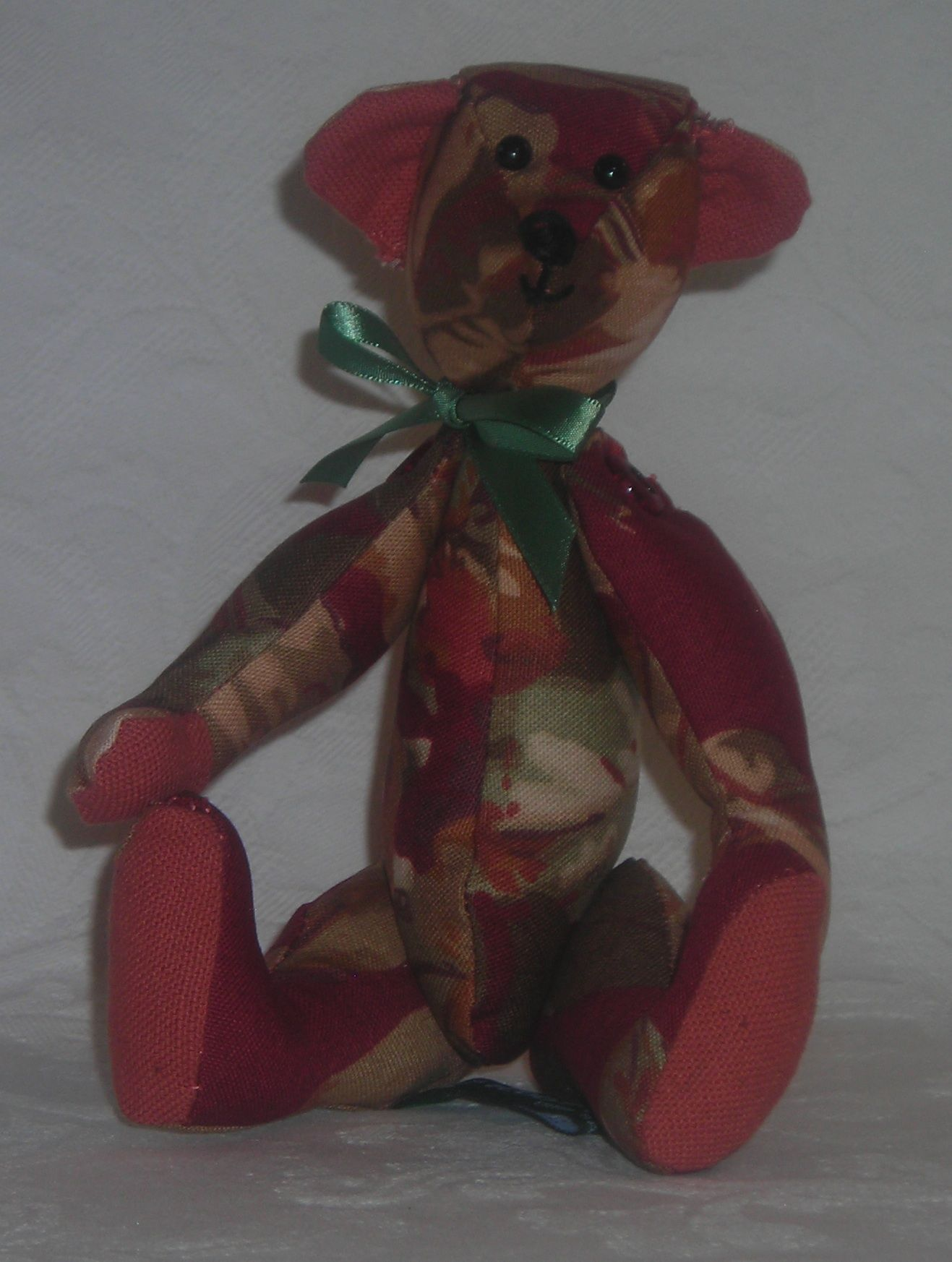 May. She is made from a cotton floral fabric with linen accents. www.facebook.com/TBearspicnic