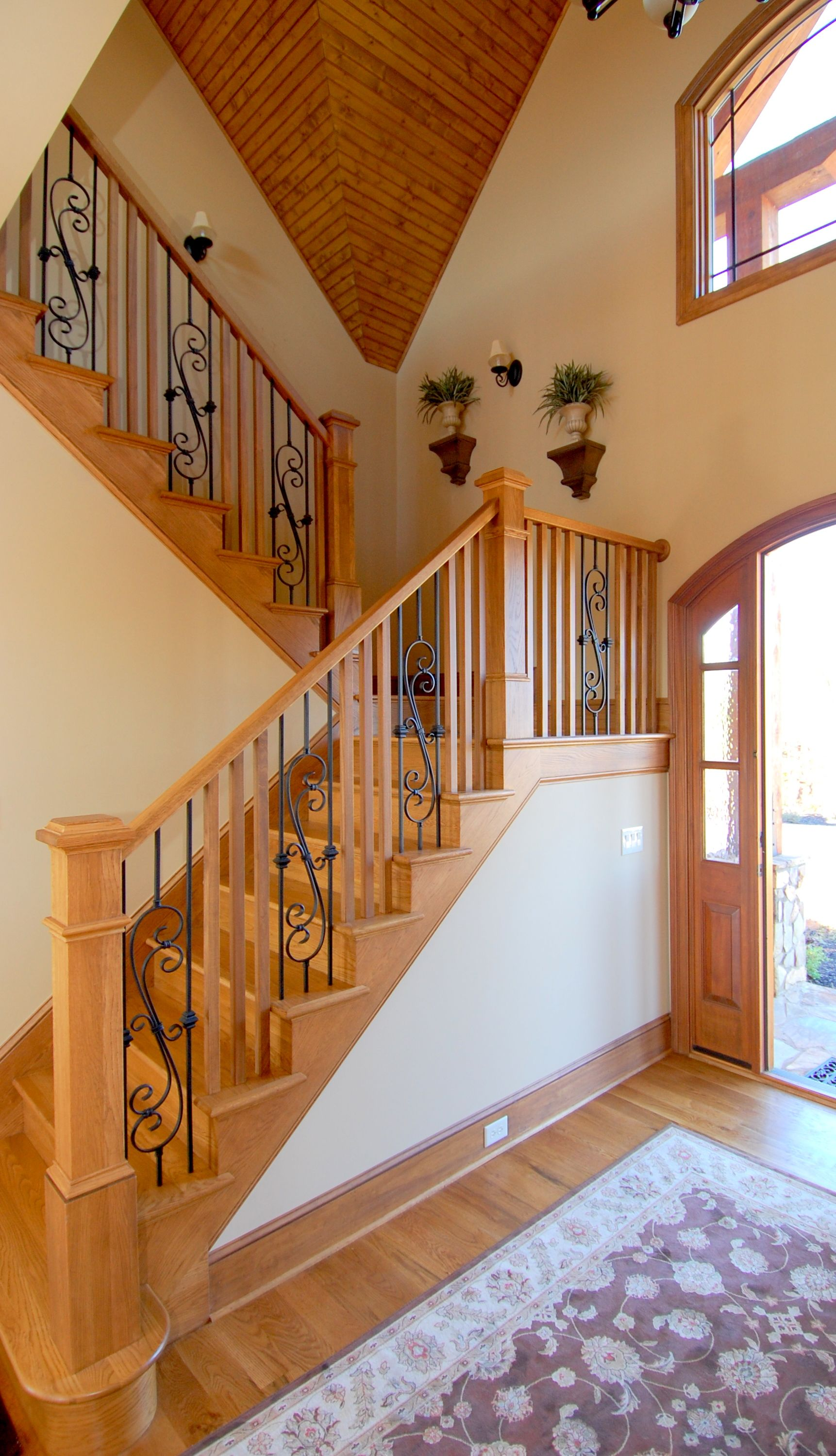 Rustic Lakefront Home Boast A All Wood And Iron Staircase Oak