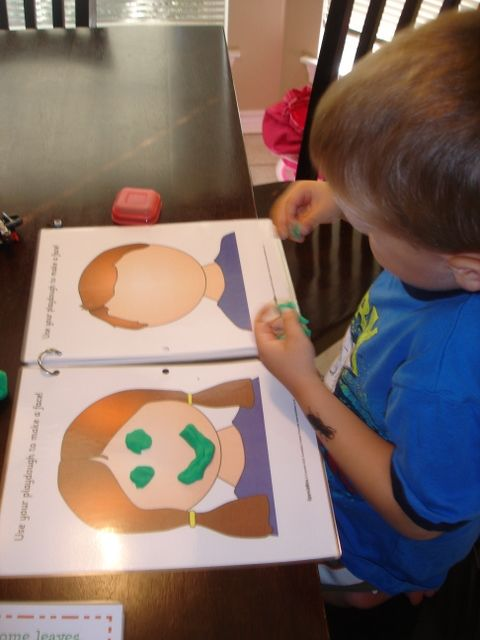 Play dough mats. This site has a lot of fun busy bag ideas/downloads.