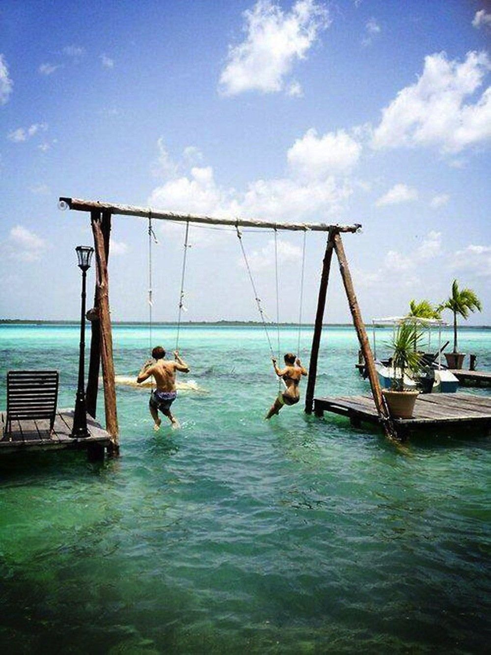 Swinging in paradise, also known as Bacalar Lagoon, Mexico.