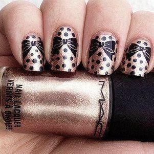 Gold and black bow nail art