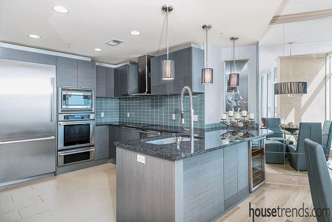 Granite countertops and a backsplash add color to a kitchen