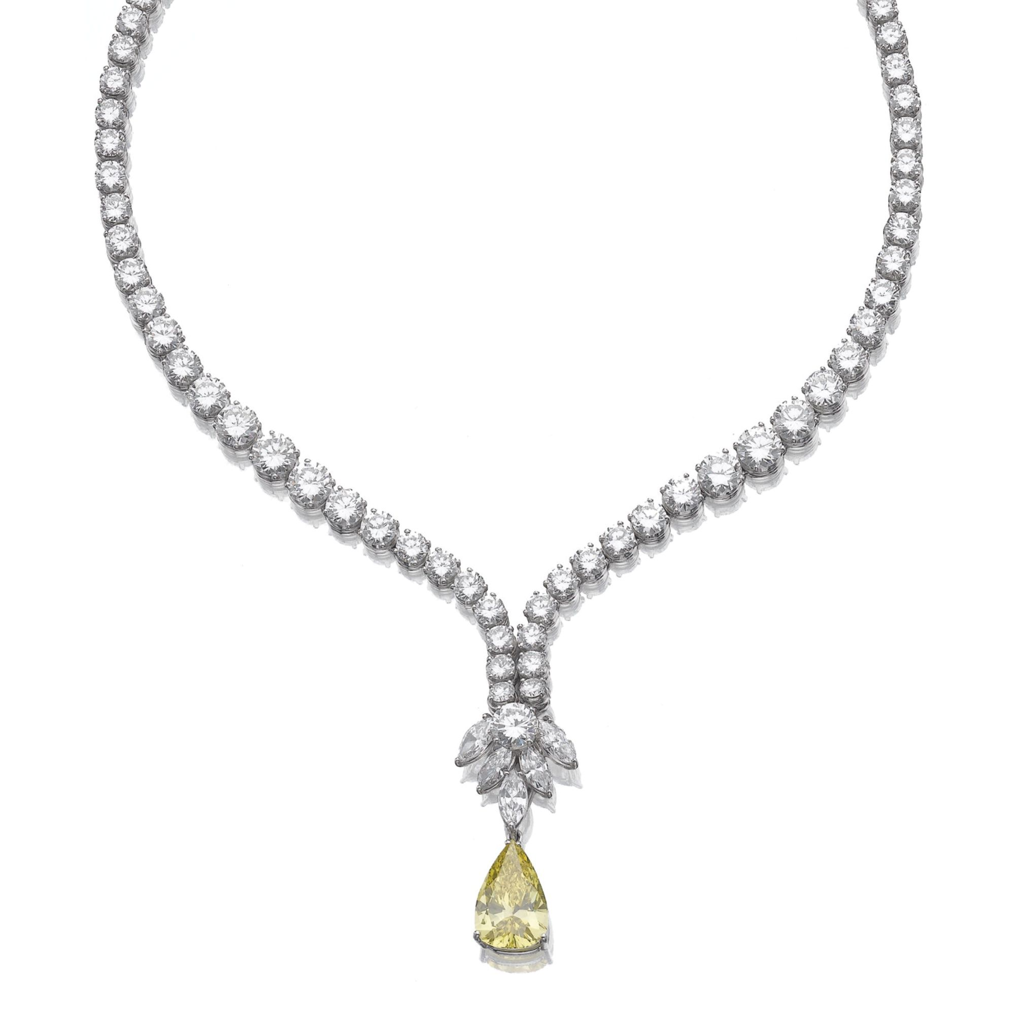 White diamond necklace featuring a yellow diamond pendant