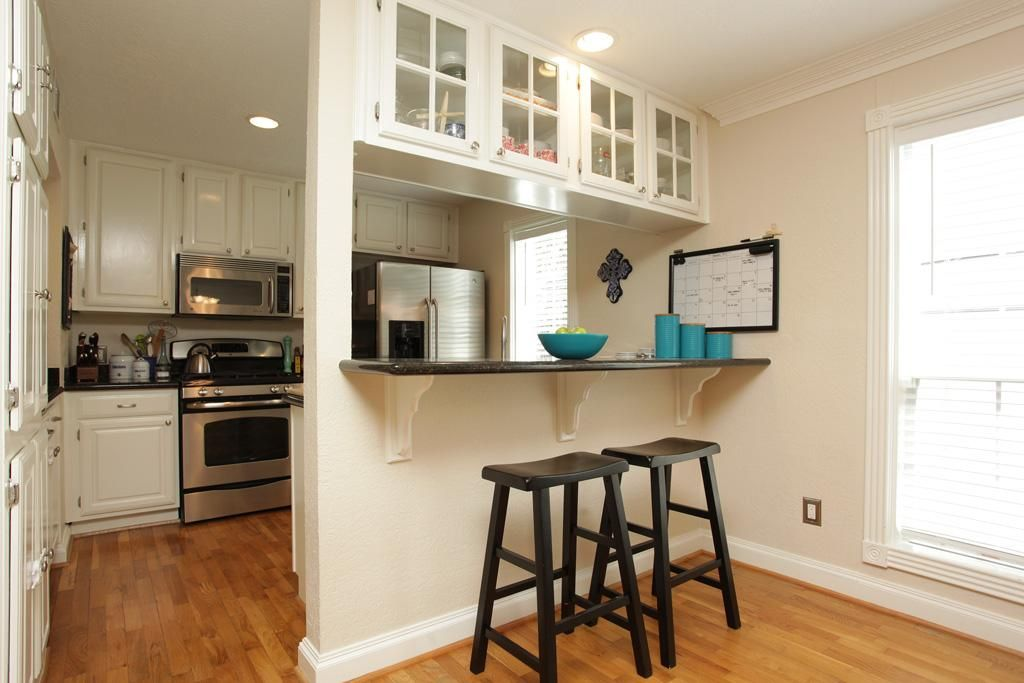 Good idea for updating cabinets over a breakfast bar. This ...