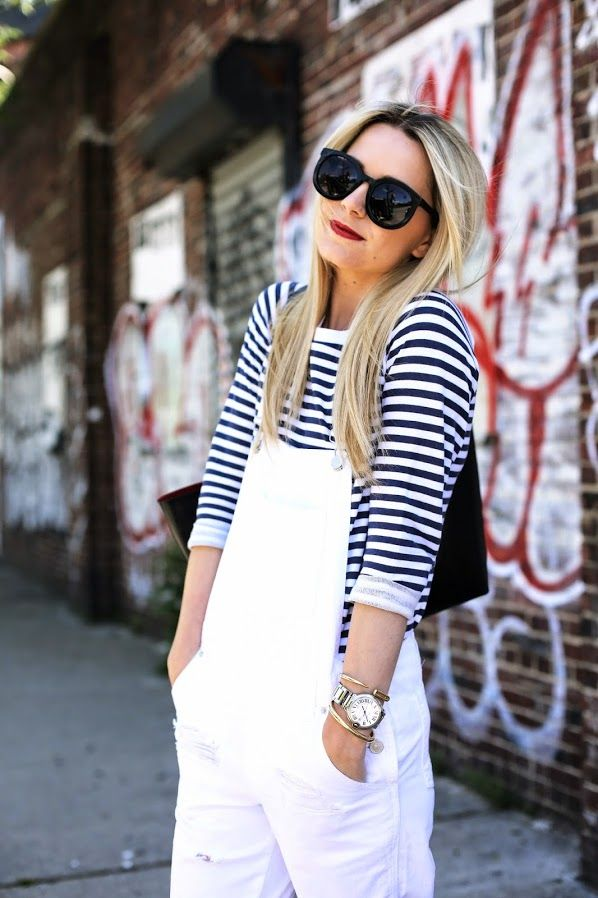 white overalls and a striped shirt