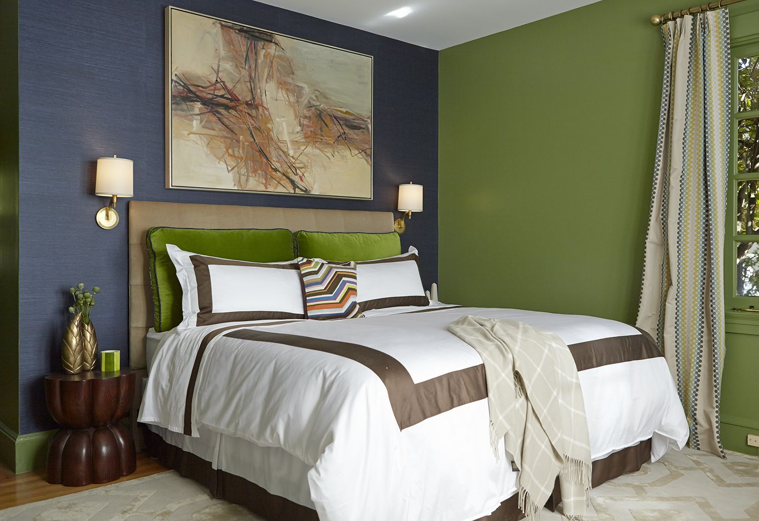 The master bedroom 39 s blue and green color scheme is brightened with crisp white linens with Brown and green master bedroom ideas