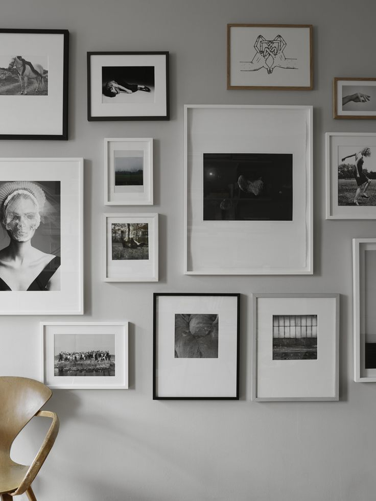 beautiful black and white picture wall on a light grey wall