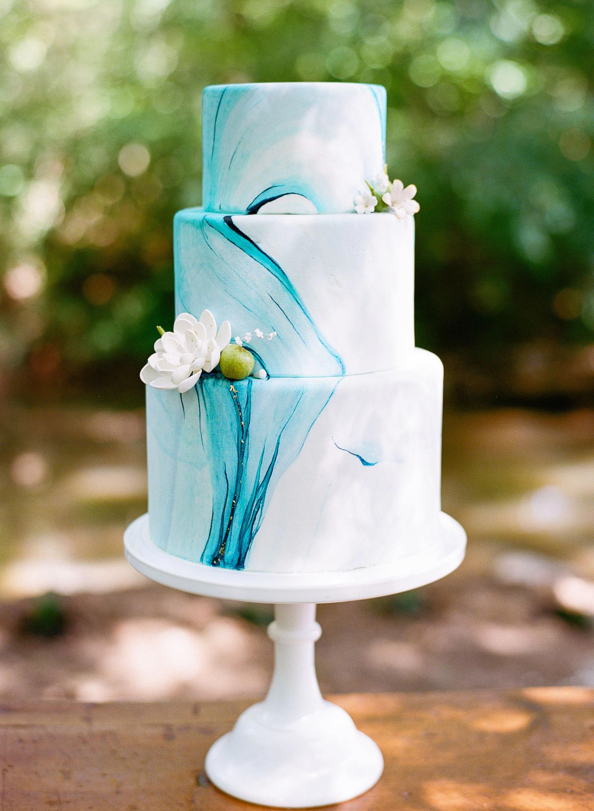 Blue marble wedding cake with gold flakes by the celestial cakery at